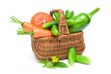 Fresh vegetables in basket isolated on white background