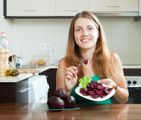 woman in green eating boiled beets