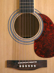 Front view of wooden classical acoustic guitar