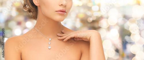 canvas print picture woman wearing shiny diamond pendant