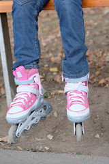 roller blades  on the legs of child