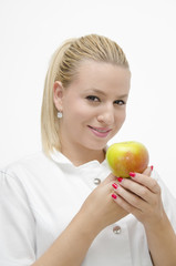 Smiley female doctor holding apple in her arms