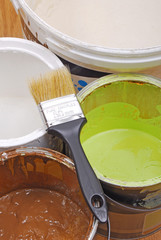 paint cans and paint brush