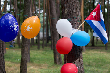 Multi colored party balloons with texas state flag