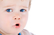 Toddler blond and blue eyes boy child with various facial expres