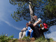 Young family enjoying sunny day in the nature