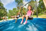 Fototapety Kids swing on playground