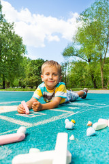 Handsome little boy with chalked image