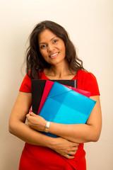 beautiful young latina holding folders