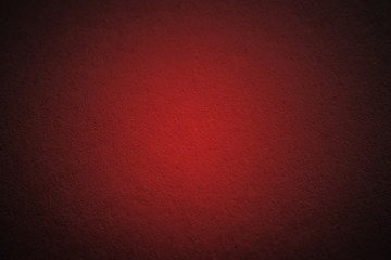 red cardboard texture or background with dark vignette borders