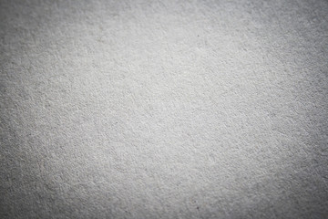 white cardboard texture or background with dark vignette borders
