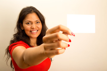 casual woman offering business card