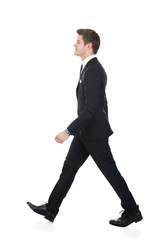Side View Of Confident Businessman Walking