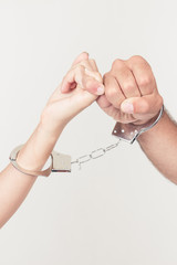 Man and woman's hands handcuffed together