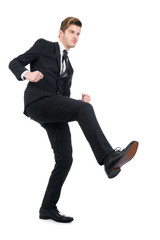Angry Businessman Kicking