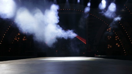 stage with light and smoke