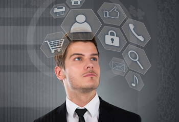 Businessman Looking At Virtual Mobile Icons