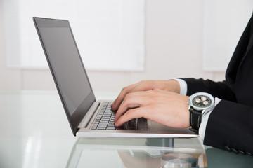 Businessman Working On Laptop At Desk