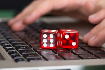 Red Game Dices On Laptop