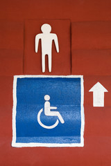 Toilet sign on wall surface