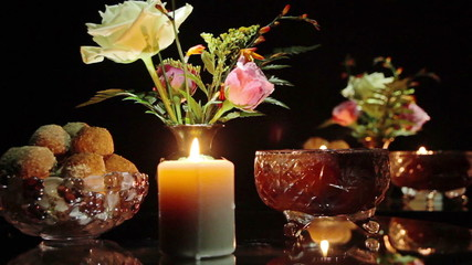 Candles, candy, flowers on the table