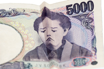 Sad face on Japanese bill