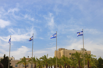 Flags of Israel and Jerusalem over blue sky