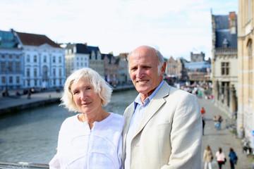 Senior couple travel in Europe enjoying city of Ghent, Belgium