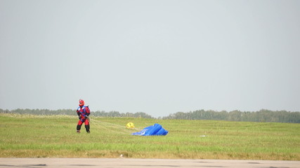 Parachutist looks at the sky after a landing