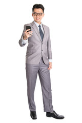 Businessman using smart phone.