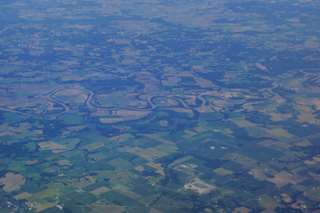 aerial photograph of rural middle USA with river running though