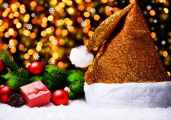 Santa hat on snow on lights background