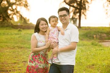 Asian family at outdoor garden park