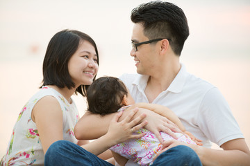 Happy Asian family at outdoor beach