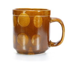 brown coffee cup on white