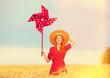 Leinwandbild Motiv Redhead girl with toy wind turbine