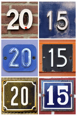 A collage of number 2015 composed from house number signs