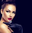 Beauty fashion glamour girl portrait over black