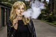 canvas print picture - Pretty woman smoking an e-cigarette