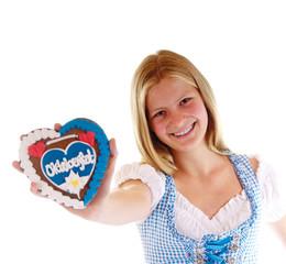 Lachendes Mädchen mit Lebkuchenherz