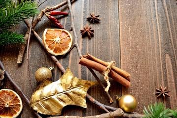 Dried orange,cinnamon stick and gold holly leaf