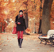 Beautiful girl walking in bright and colorful autumn park