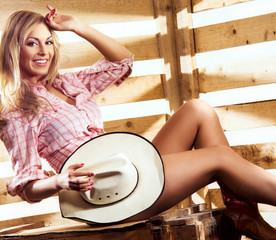 Young, happy and sexy naked cowgirl in western style