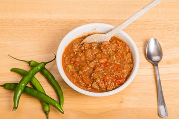 Chili with Peppers and Wood Spoon