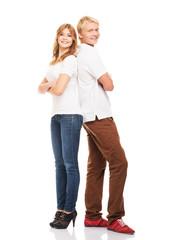 Stylish teenage couple standing isolated on white