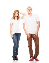 Stylish teenage couple standing isolated on white