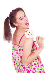 Portrait of laughing girl  holding big lollipop