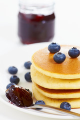 Pancake on white with jam a
