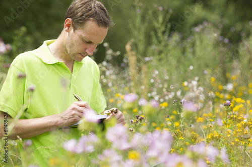 Enviromental scientist researching the environment and natural d - 69489424