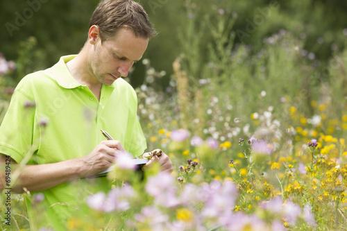 Leinwanddruck Bild Enviromental scientist researching the environment and natural d